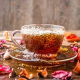 Transparent mug with herbal tea Royalty Free Stock Photo