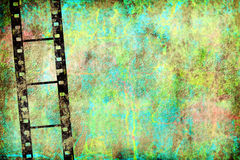 Transparent negative film by old grunge wall Royalty Free Stock Images
