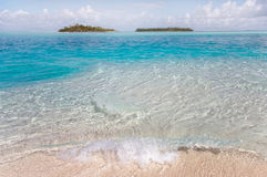 Transparent ocean water near Maldivian island. Transparent blue ocean water with wave near Maldivian island Royalty Free Stock Images