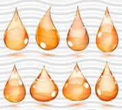 Transparent orange drops Royalty Free Stock Photography