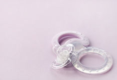 Transparent pacifier on pink background Royalty Free Stock Images