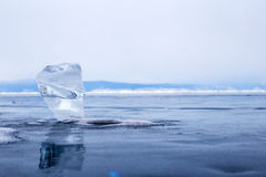 A transparent piece of ice on surface of blue lake Baikal Stock Image