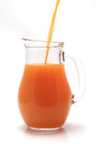 Transparent pitcher with orange juice royalty free stock photo
