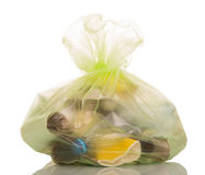 Transparent plastic bag with household waste isolated on white. Transparent plastic bag with household waste isolated on white background Stock Image