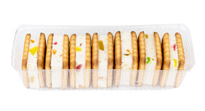 Transparent plastic box with biscuits sandwiches isolated on whi Stock Photos