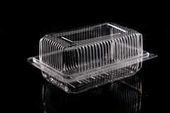Transparent plastic box on black background. Royalty Free Stock Images