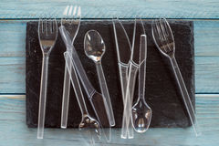 Transparent plastic cutlery. On black background Royalty Free Stock Image