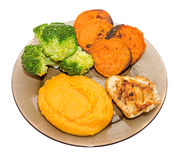 Transparent plate with fresh green broccoli, smashed sweet potatoes and slice of orange sweet potatoes, chiken meat Royalty Free Stock Photo