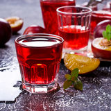 Transparent plum drink Royalty Free Stock Images