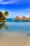 The transparent pool and lodges over the sea Stock Photo