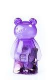 Transparent purple piggy bank with money Stock Images