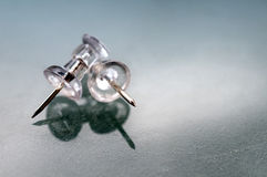 Transparent push pins Royalty Free Stock Photo