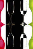 Transparent and the red-green wine glasses on the black-and-white background with reflection. Stock Photo