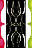 Transparent and the red-green wine glasses on the black-and-white background with reflection Stock Images