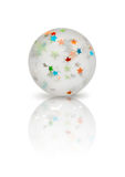 Transparent rubber ball with colorful stars inside  on w Royalty Free Stock Photo