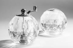 Transparent salt shaker and manual mill Stock Images