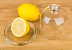 Transparent saucer with lid and lemon on table Royalty Free Stock Image