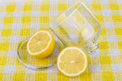 Transparent saucer with lid and lemon on tablecloth Royalty Free Stock Photo