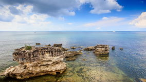 Transparent Sea Waves Wash Speckled with Wind Stones. Transparent azure sea waves wash speckled with wind stones against blue sky white clouds stock footage