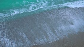 Transparent sea waves washing up on sand beach, eternity, unstoppable force. Stock footage stock footage