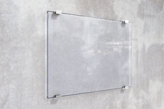 Transparent signboard on concrete wall Royalty Free Stock Image