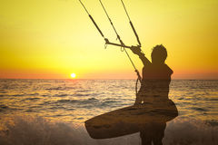 Transparent silhouette of kite surfer at sunset Royalty Free Stock Photos