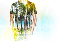 A transparent silhouette of a man in the t-shirt. Tropical island landscape on the background Stock Image