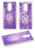 Transparent silicone case for smartphone with violet moving sparkles in the shape of hearts royalty free stock photos