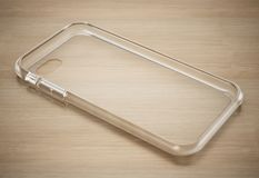 Transparent silicone smartphone cover standing on wooden surface. 3D illustration.  vector illustration