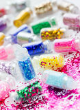 Transparent small bottles with glitter makeup and nail art Stock Photos