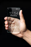 Transparent smartphone with hand on black background Royalty Free Stock Photos