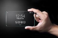 Transparent smartphone with hand on black background Stock Photos