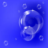 A transparent soap bubble background design. With a series of transparent bubbles on a blue base with room for text stock illustration