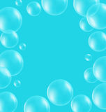 Transparent soap bubbles like frame on blue Royalty Free Stock Image