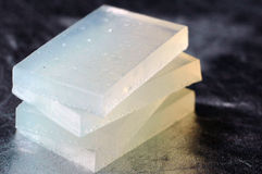 Transparent soap on a silver background. The transparent handmade soap on a silver background Stock Images