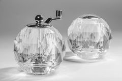 Transparent spherical salt shaker and manual mill Royalty Free Stock Photo