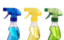Transparent spray bottles on white background Stock Photos