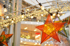 Transparent star and lightbulb decoration Royalty Free Stock Image