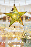 Transparent star and lightbulb decoration Stock Images