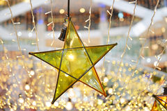Transparent star and lightbulb decoration Stock Photography