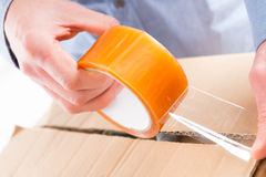 Transparent tape in hands Stock Image