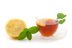 Transparent teacup with tea Royalty Free Stock Photos