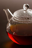 Transparent teapot with black tea Royalty Free Stock Photo