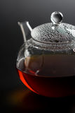 Transparent  teapot with black tea Royalty Free Stock Photography