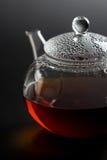 Transparent  teapot with black tea Royalty Free Stock Photography