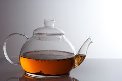 Transparent teapot with herb tea Royalty Free Stock Images