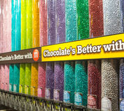 Transparent tubes filled with M&M candies by Mars Stock Photos