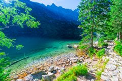 Transparent turquoise water Sea Eye the lake in the Tatra Mountains, Poland, stock images