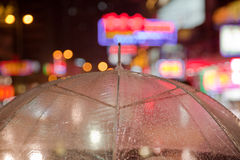 Transparent umbrella. With city lights Royalty Free Stock Images