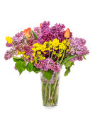 Transparent vase with colored flowers Royalty Free Stock Image